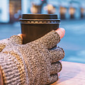 Gloved Hands Holding Coffee Cup by Sophie McAulay