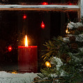 Glowing Christmas Candle In Frosted Home Window by Thomas Baker