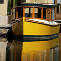 Gold Boat Reflects by Norman Andrus
