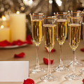 Gold Glitter Wedding Reception Setting With Champagne by U Schade