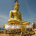 Golden Buddha Statue, Tiger Cave Temple by Aivar Mikko