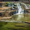 Golden Leaves And Mossy Tiers Of Enfield Glen Waterfall by Karen Jorstad
