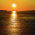 Golden Sunset Light On The Ice Two  by Lyle Crump