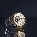 Golden Watch On Dark Background by Sergiu Sichim
