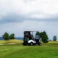 Golfing Before The Rain Golf Cart 02 by Thomas Woolworth