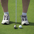 Golfing Lining Up The Putt by Thomas Woolworth