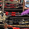 Gondolas Parked In Venice by Michael Henderson