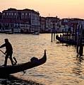 Gondolier In Venice In Silhouette by Michael Henderson