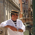 Gondolier In Venice Waiting For A Fare by Michael Henderson