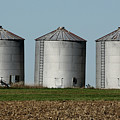 Grain Bins In A Row by Alan Look