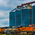 Grain Silos And Bnsf Train by Ginger Wakem