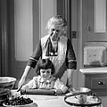 Grandmother And Granddaughter Baking by H. Armstrong Roberts/ClassicStock