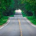 Grassy Lake Road by John Diebolt