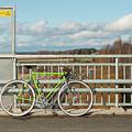 Green Bicycle On Bridge by Ilari