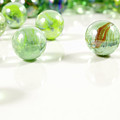 Green Glass Marbles Close-up Views by Daniel Ghioldi