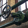 Green Manual Valve In Green Metal Tube by Compuinfoto