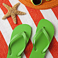 Green Sandals On Beach Towel by Garry Gay