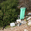 Green Trash Bag And Rubbish In Croatia by Stefan Rotter