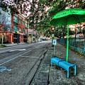 Green Umbrella Bus Stop by Michael Thomas