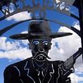 Gunfighter In Metal Welcome Sign  2 Allen Street Tombstone Arizona 2004 by David Lee Guss