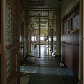 Hallway With Solitary Confinement Cells In Prison Hospital by Karen Foley