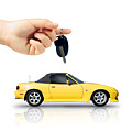 Hand Holding Key To Yellow Sports Car by Jorgo Photography - Wall Art Gallery