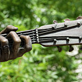 Hank Williams Hand And Guitar by Debra Martz