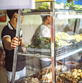 Hanoi, Vietnam  Vietnamese Street Food Seller Li by Eduardo Huelin