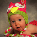 Happy Baby In A Woollen Hat by Leighton Collins