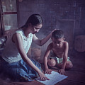 Happy Family Sisters And Brothers Read Books In The Evening At H by Somchai Sanvongchaiya