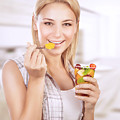 Happy Woman Eat Fruit Salad by Anna Om