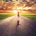 Happy Woman Jumping On Long Straight Road by Michal Bednarek