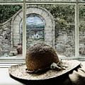 Hat In Window by Joselyn Holcombe
