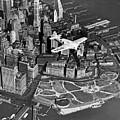 Hawk's Plane Over Battery Park by Underwood Archives