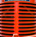 Head On To An Old Case Tractor Grill In Classic Orange Paint by John Brink