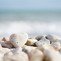 Heart Shaped Pebble On The Beach by Alexandre Fundone