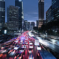 Heavy Traffic Rushing Along The Sudirman Avenue In The Heart Of Jakarta Business District  by Didier Marti