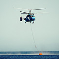 Helicopter Firefighter Take Water In The Sea by Raimond Klavins
