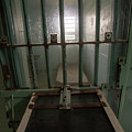 High Risk Solitary Confinement Cell In Prison Through Bars by Karen Foley