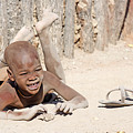Himba Boy With Sandal by Aivar Mikko
