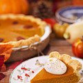 Homemade Pumpkin Pie On A Rustic Table With Autumn Decorations by Sara Winter