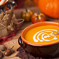 Homemade Pumpkin Soup On A Rustic Table With Autumn Decorations by Sara Winter