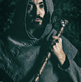 Hooded Man With Axe by Amanda Elwell
