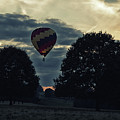 Hot Air Balloon Between The Trees At Dusk by Scott Lyons