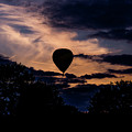 Hot Air Balloon Silhouette At Dusk by Scott Lyons