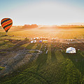 Hot Air Balloon Taking Off At Sunrise by William Freebilly photography
