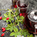 Hot Rosehip Tea In Glass by Wolfgang Steiner