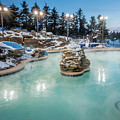 Hot Tubs And Ingound Heated Pool At A Mountain Village In Winter by Alex Grichenko