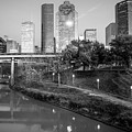 Houston Texas Skyline On The Buffalo Bayou - Black And White by Gregory Ballos
