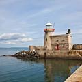 Howth Lighthouse by Gabriela Insuratelu